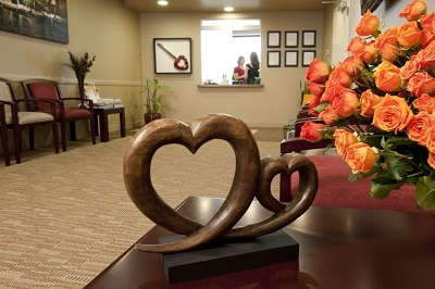 heart shaped wood sculpture in Plano TX cardiology office
