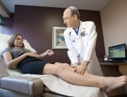 examining patients legs for spider or varicose veins in Plano TX